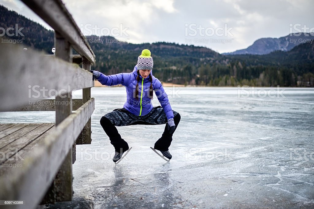 Woman warming up on the frozen lake stock photo
