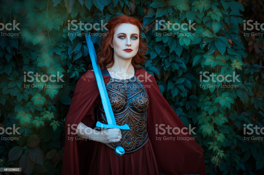 Woman warrior with sword wearing a cuirass. stock photo