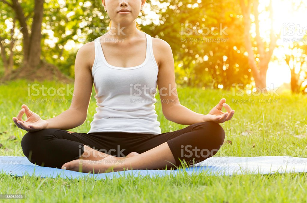 woman was meditation yoga in park at eveing stock photo