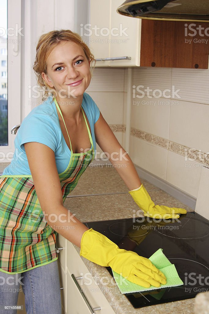 Woman washes a plate on kitchen royalty-free stock photo