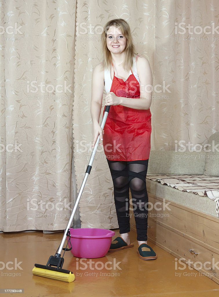 woman washes the floor with mop stock photo