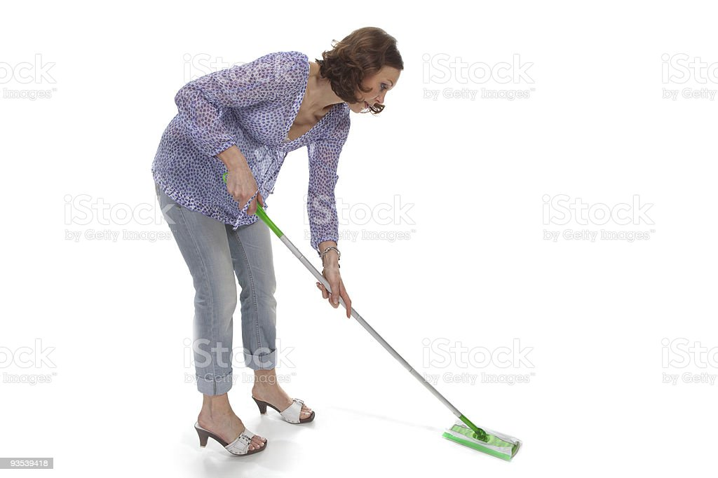 woman washes up the floor by a swab stock photo