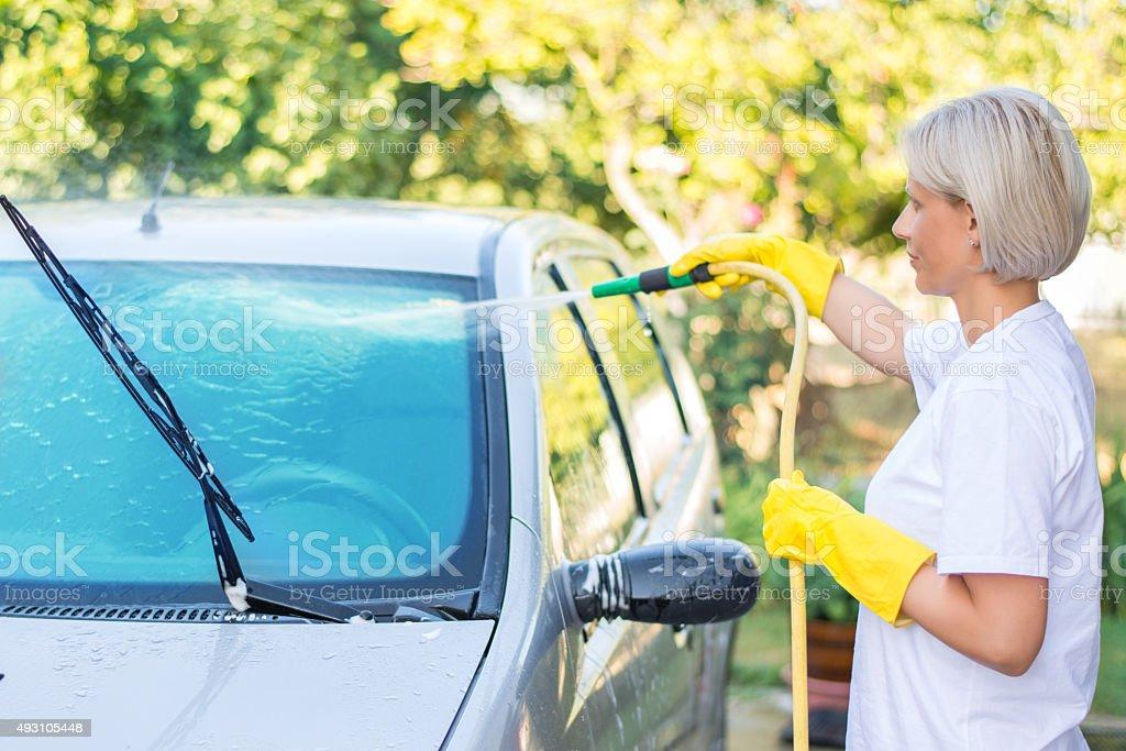Woman washing a car stock photo