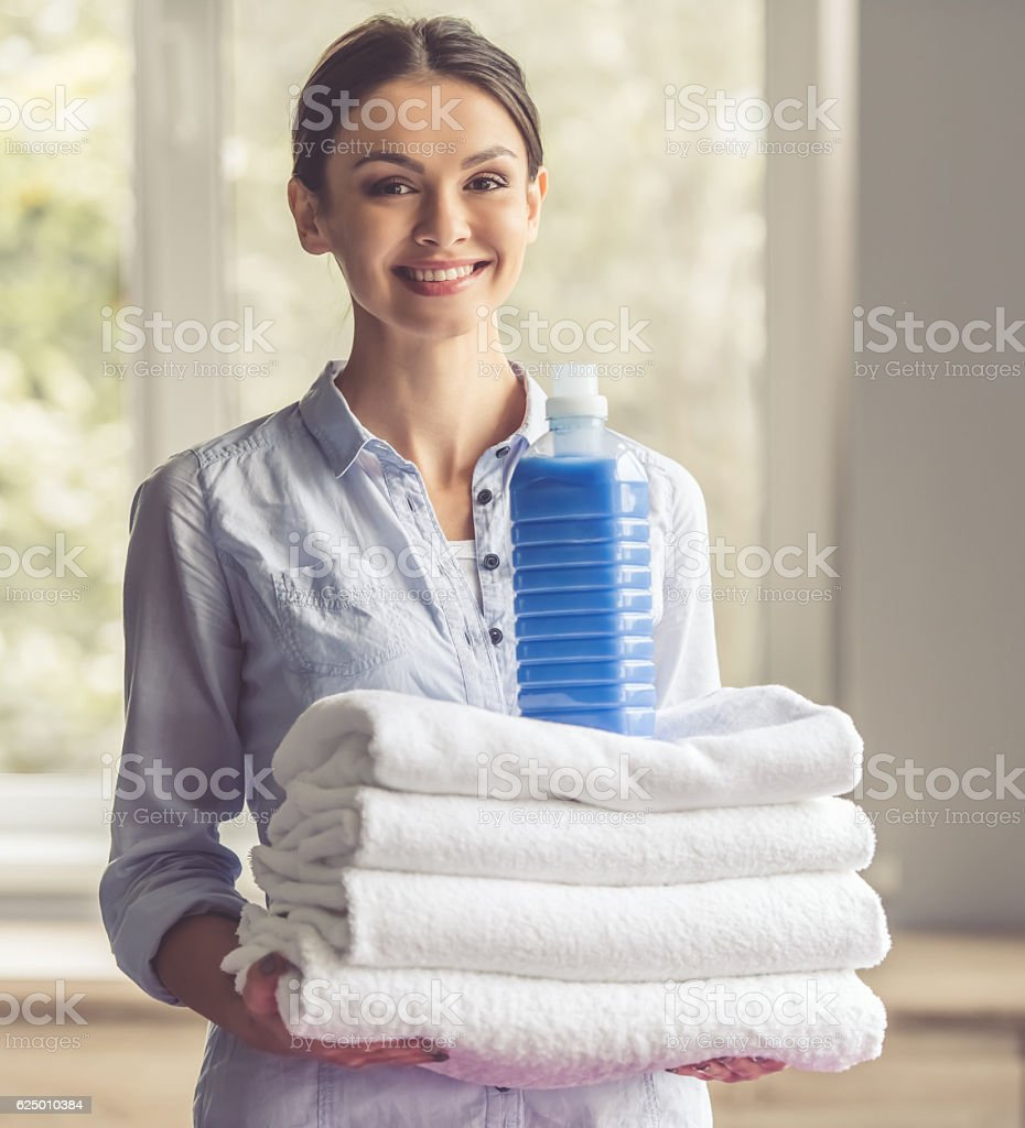 Woman washing clothes stock photo