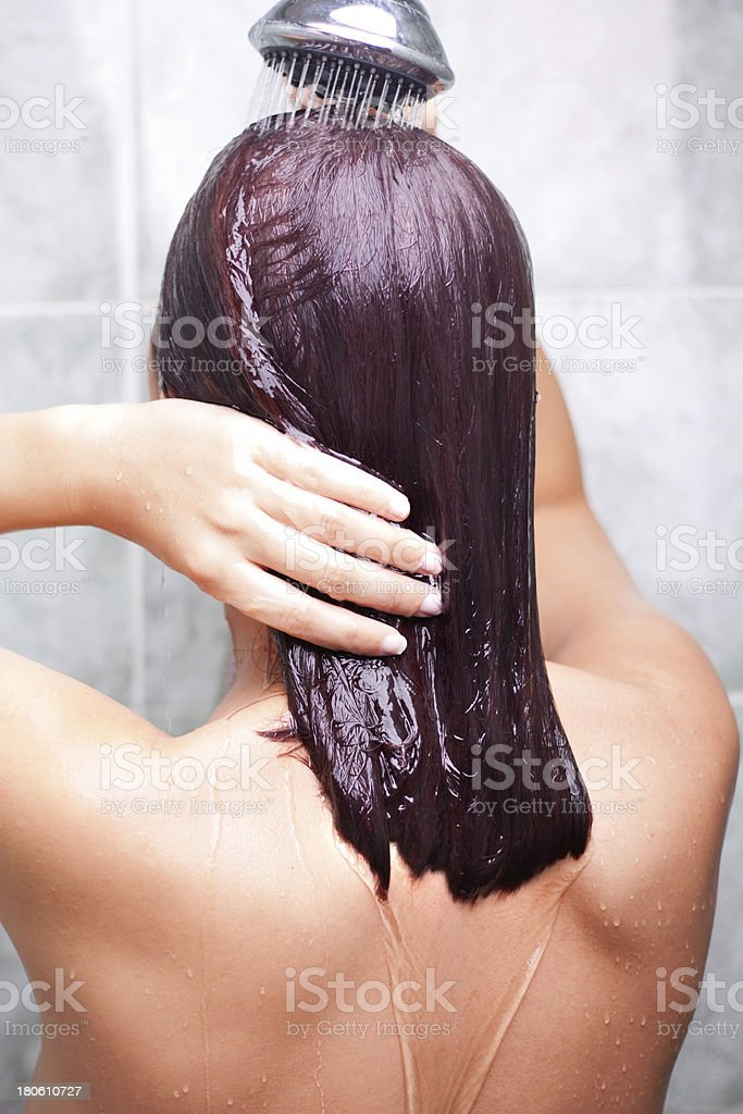 Woman washing colored hair stock photo