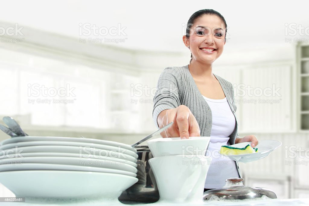 woman washing dishes in the kitchen stock photo