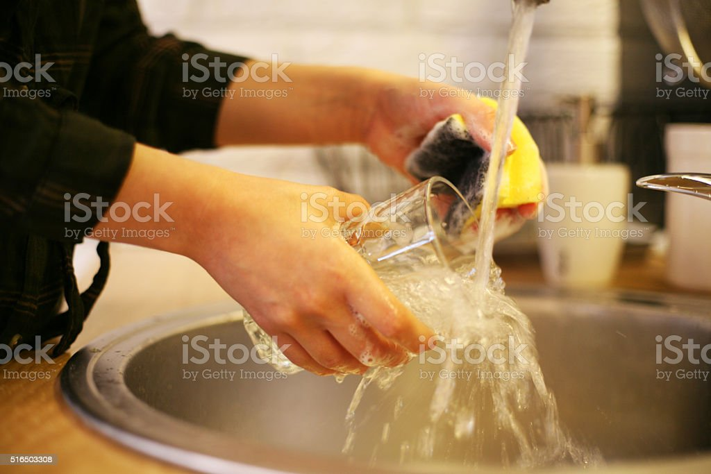Woman washing dishes. stock photo