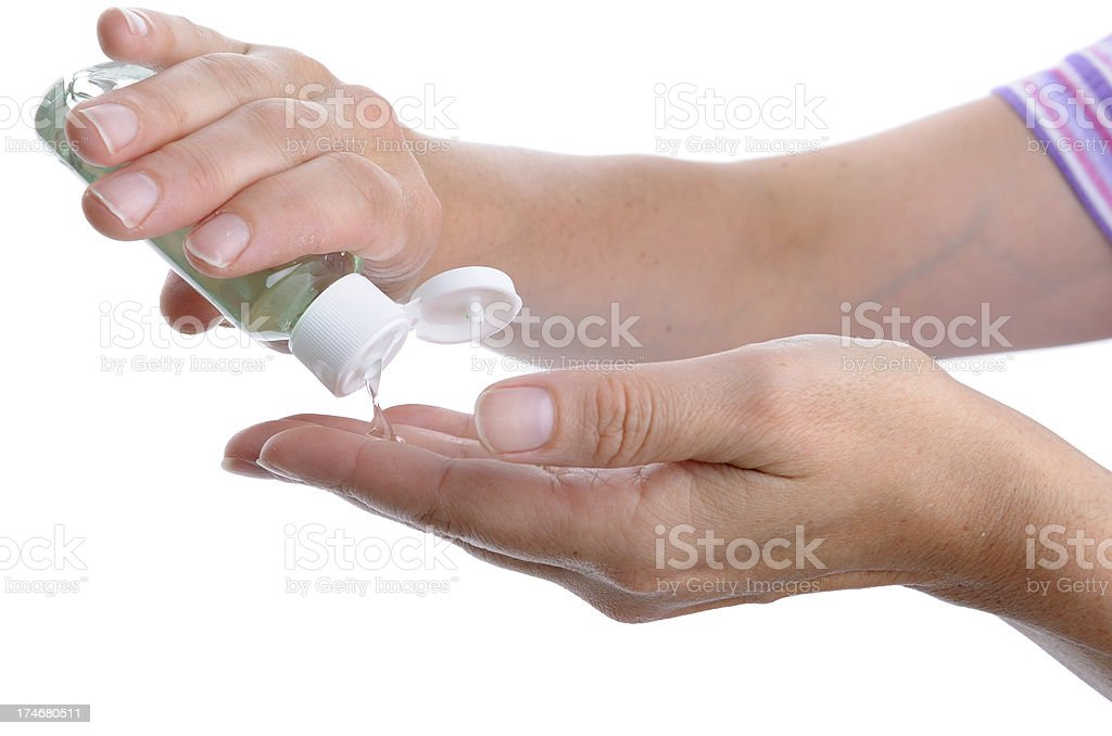Woman Washing Hands with Alcohol Sanitizer stock photo