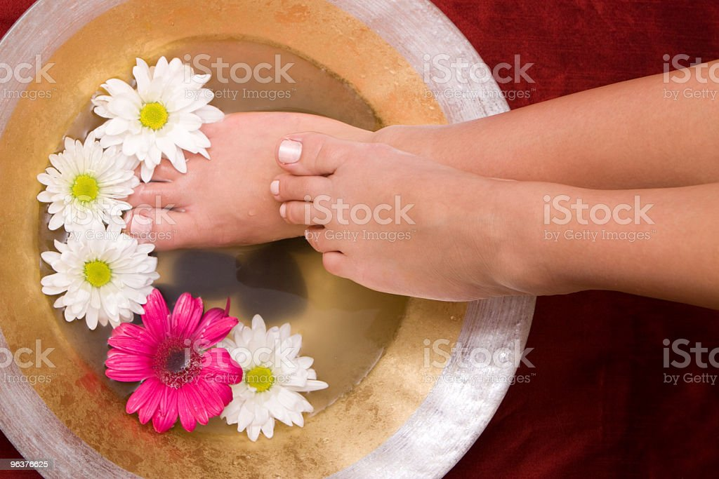 Woman washing her feet in a bowl royalty-free stock photo