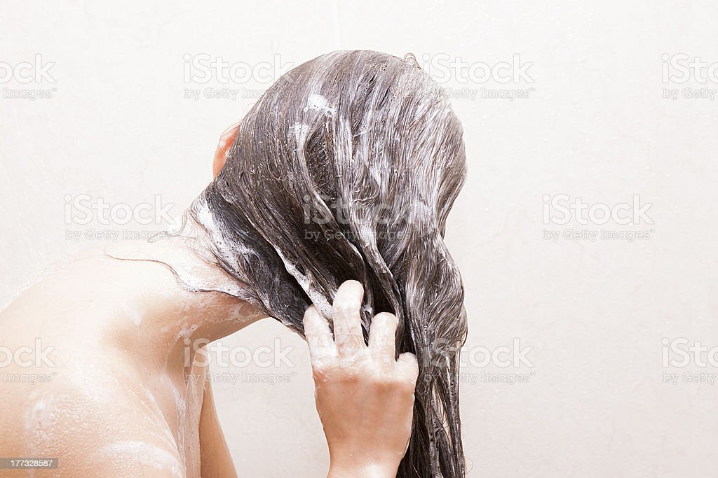 Woman washing her hair stock photo