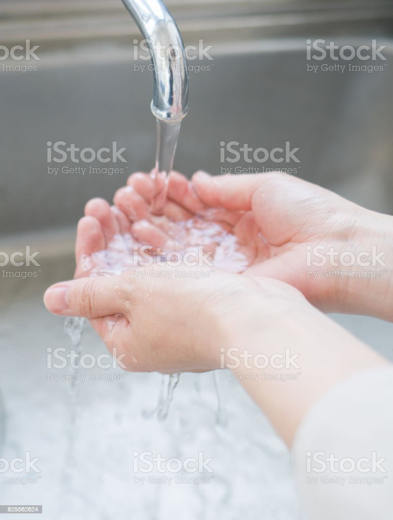 Woman washing her hands stock photo