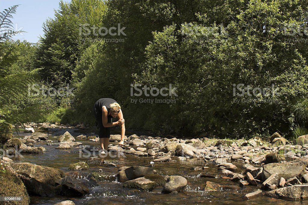 Woman washing in stream royalty-free stock photo