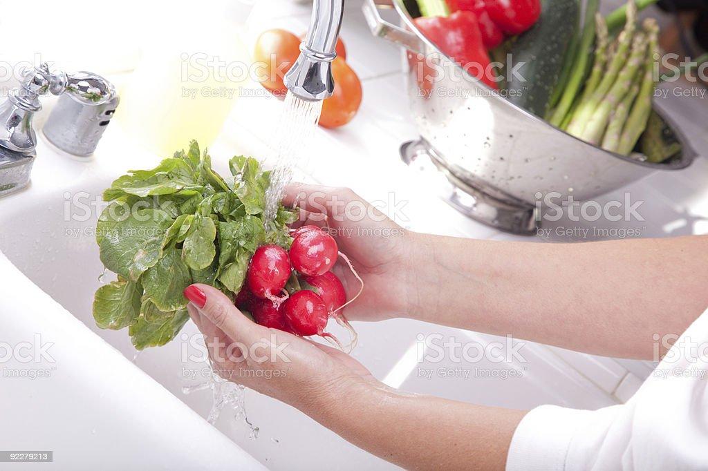 Woman Washing Radish - XXXL royalty-free stock photo