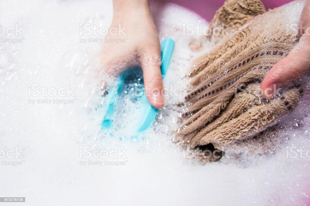 Woman washing towel stock photo