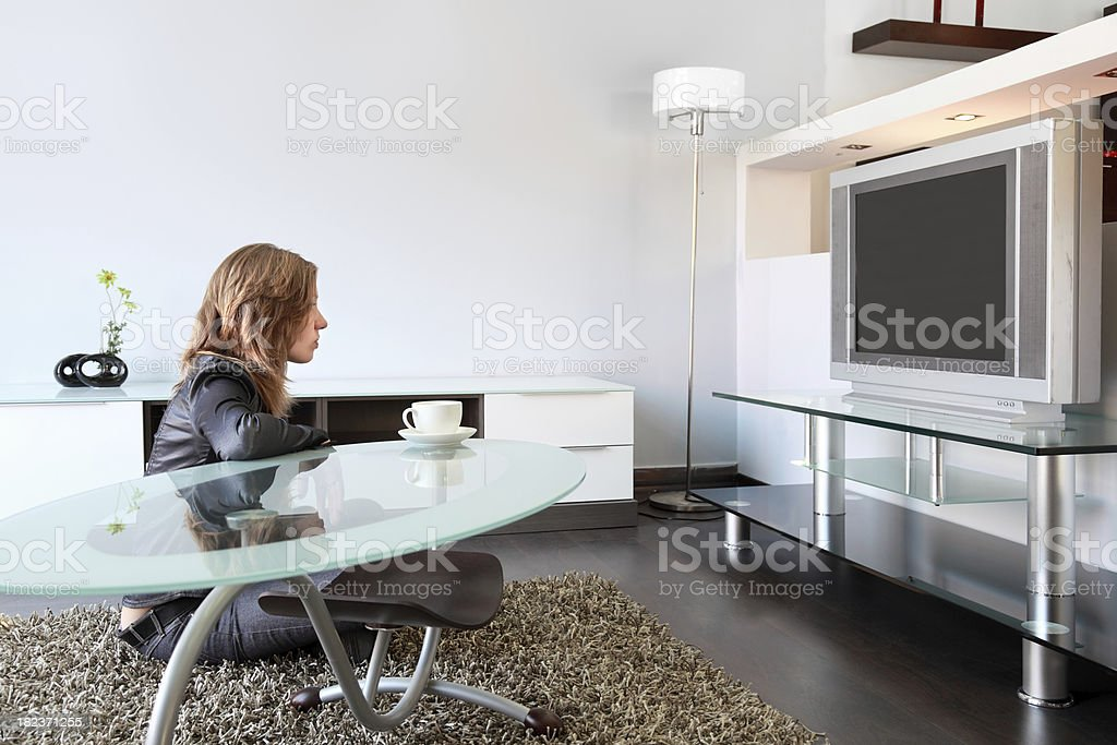Woman watches TV royalty-free stock photo