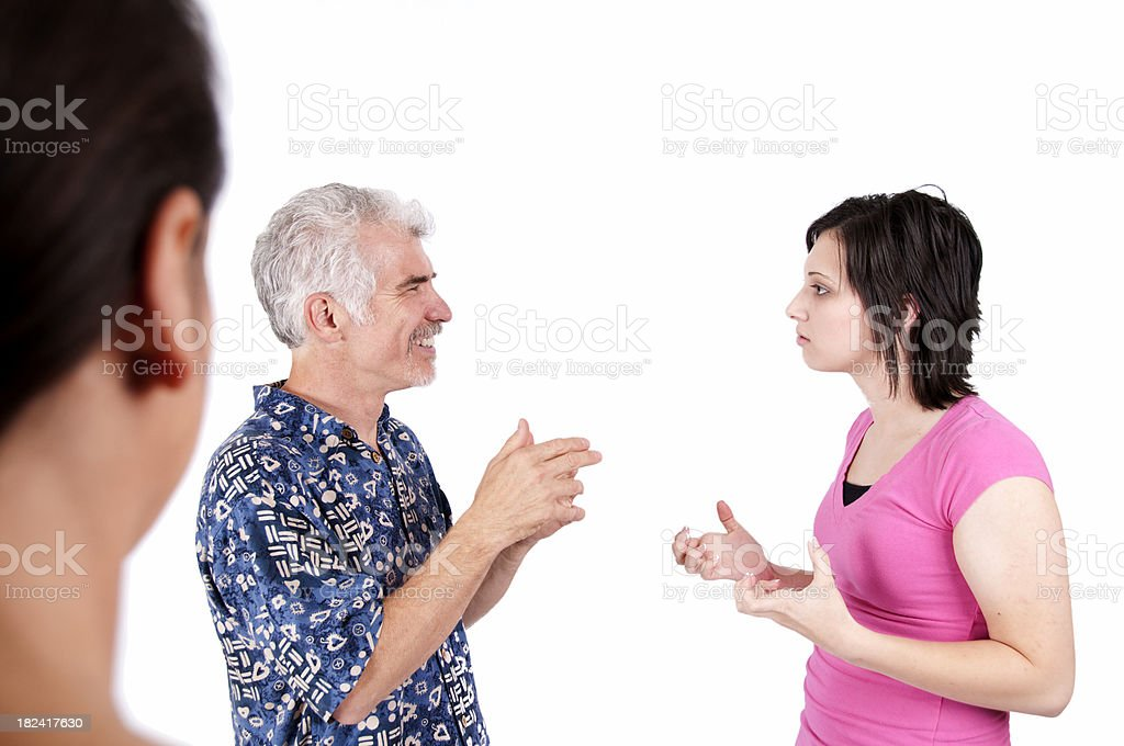 Woman watching a couple of other people signing using ASL stock photo
