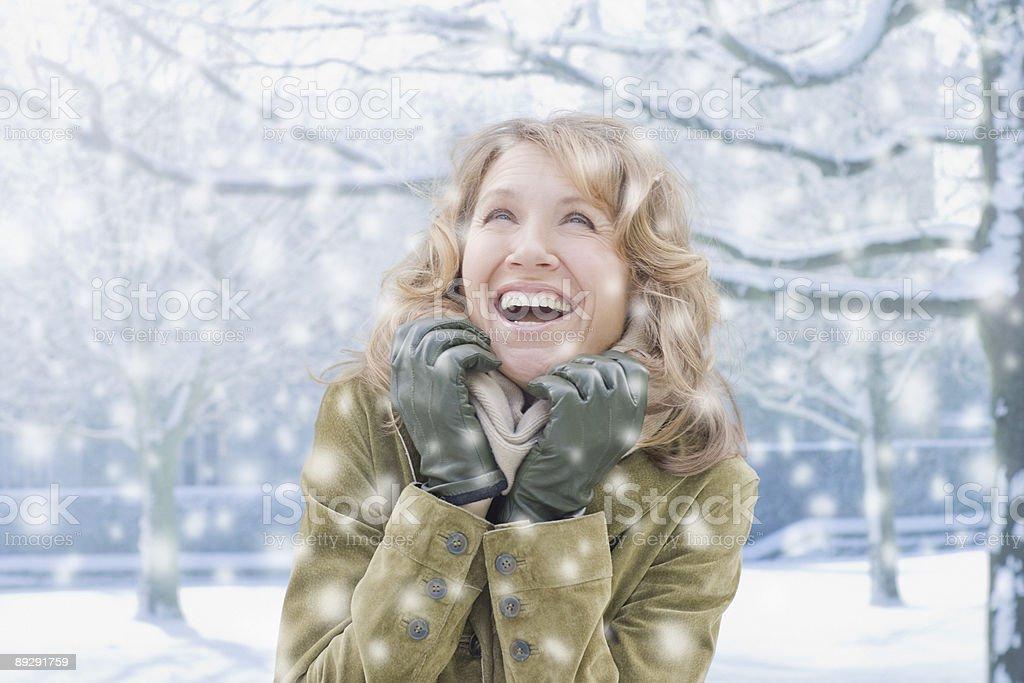 Woman watching falling snow  stock photo
