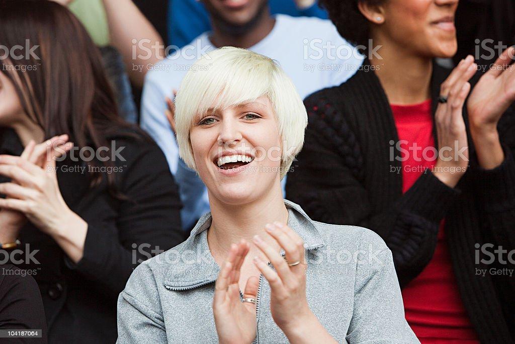 Woman watching football match royalty-free stock photo