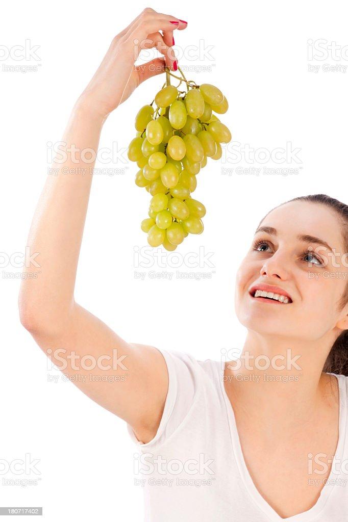 Woman watching grapes royalty-free stock photo