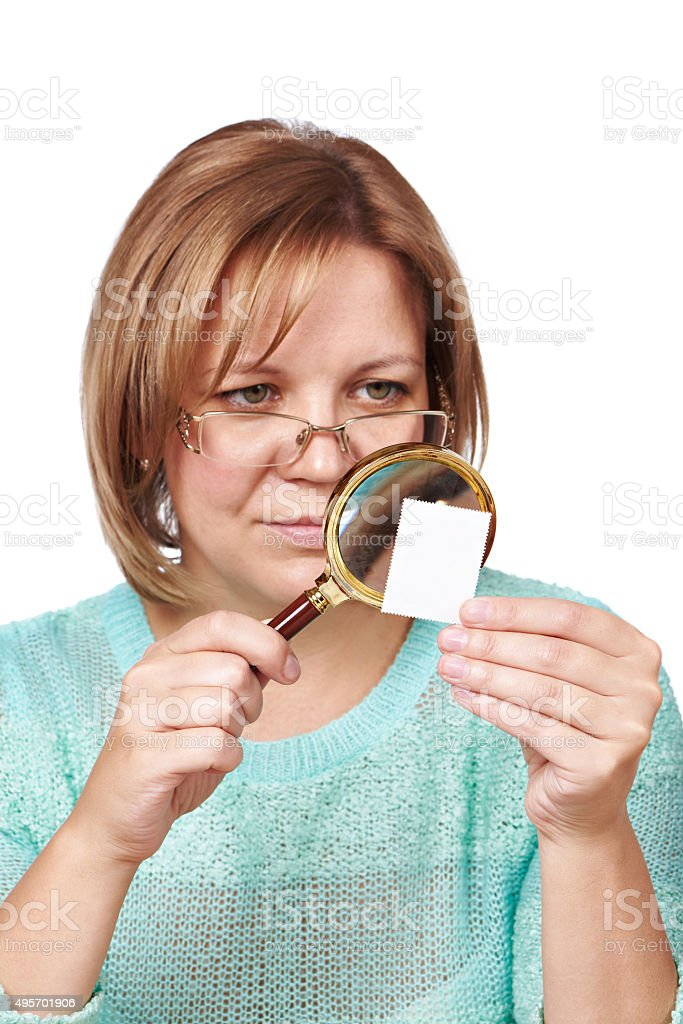 Woman watching postage stamps stock photo
