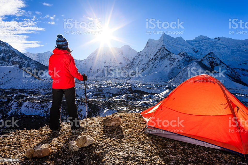 Woman watching sunrise in Himalayas, Mount Everest National Park stock photo
