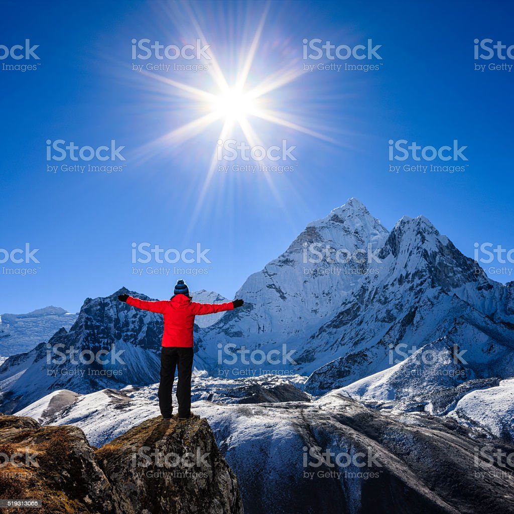 Woman watching sunrise over Himalayas, Mount Everest National Park stock photo