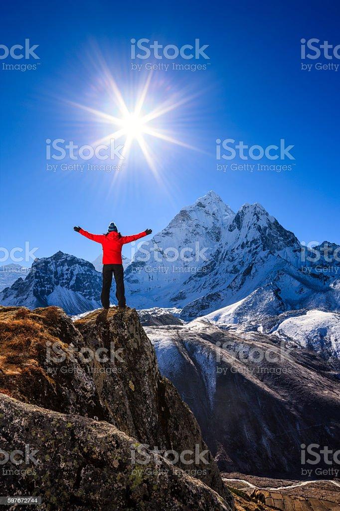 Woman watching sunrise over Himalayas, Mount Everest National Park stock photo