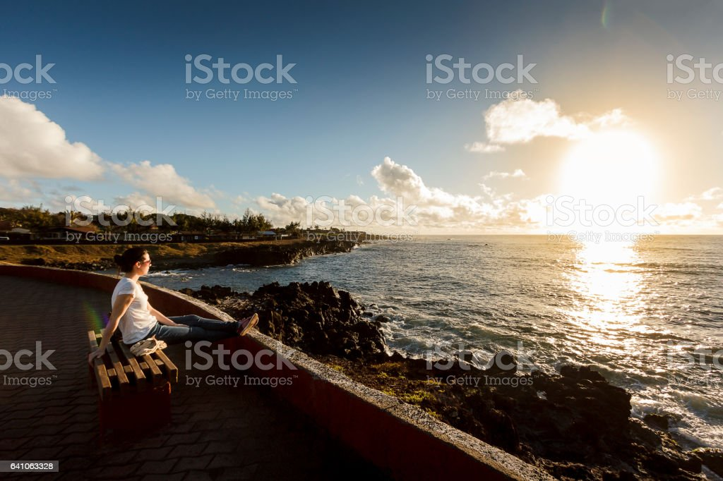Woman Watching Sunset in Easter Island stock photo