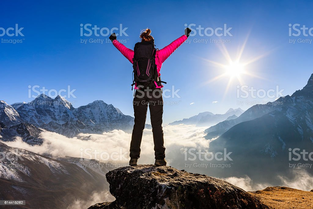 Woman watching sunset in Mount Everest National Park stock photo