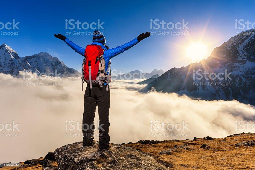 Woman watching sunset over Himalayas, Mount Everest National Park stock photo