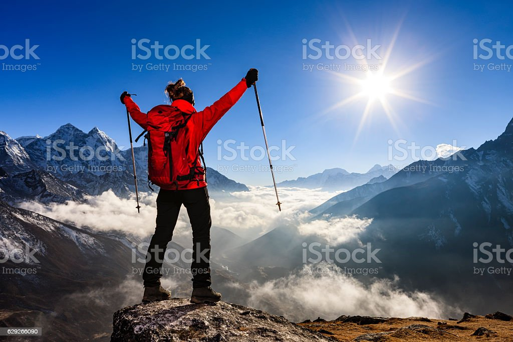 Woman watching sunset over Himalayas, Mount Everest National Park stock photo