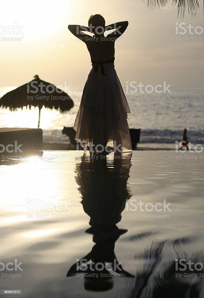 Woman watching sunset royalty-free stock photo