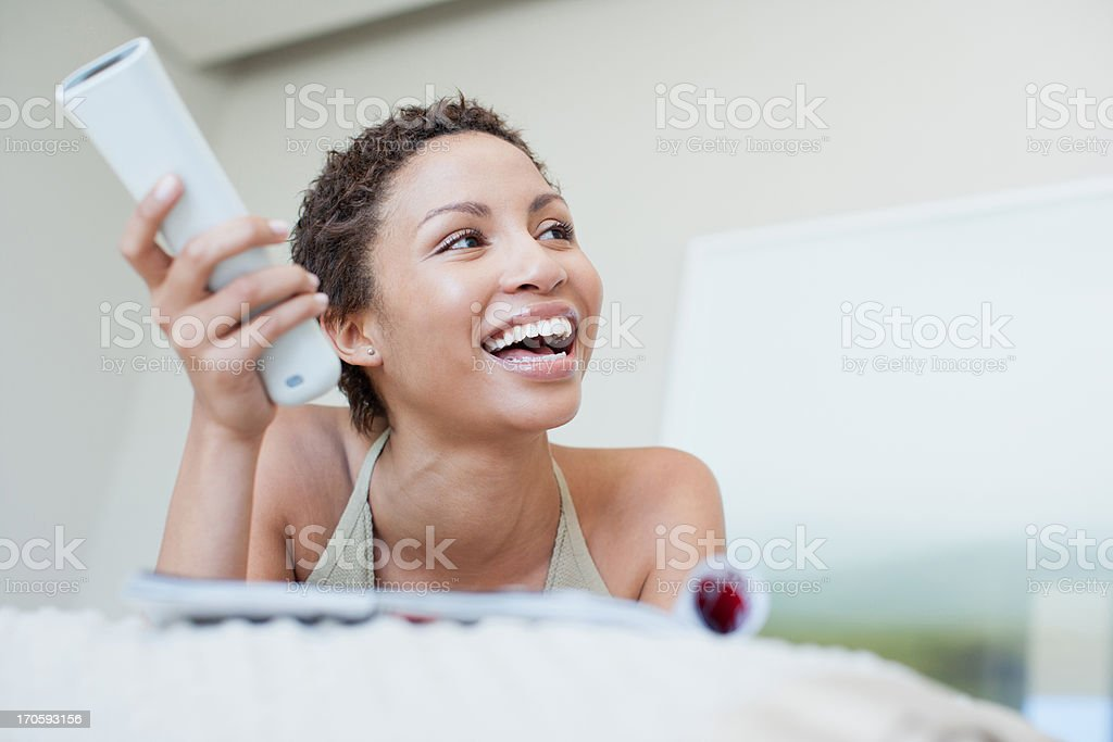 Woman watching television royalty-free stock photo