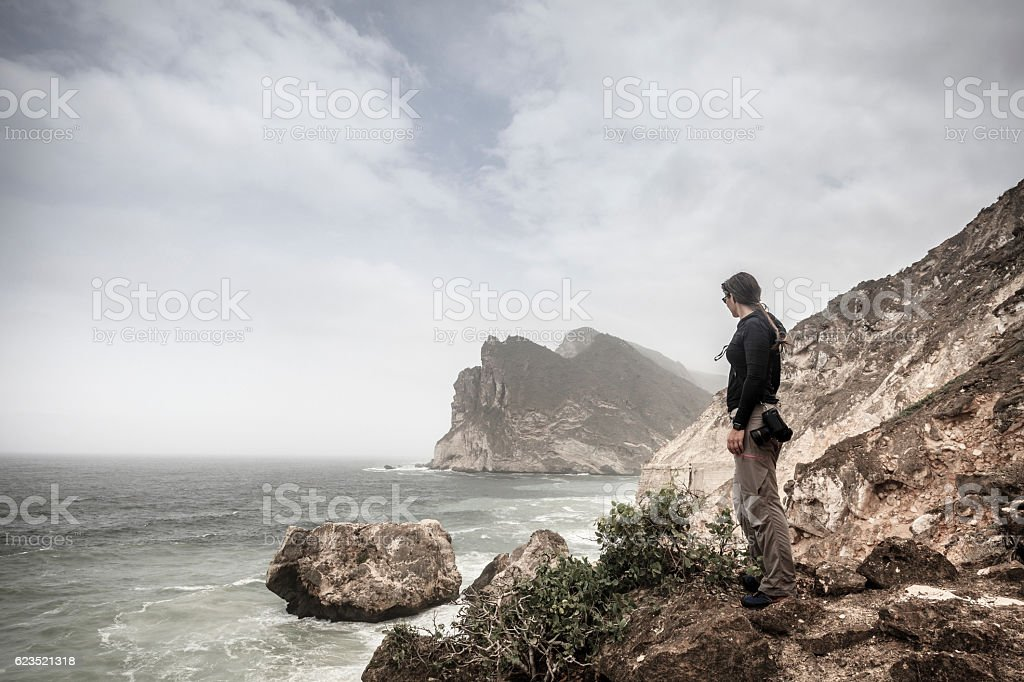 Woman watching the sea stock photo