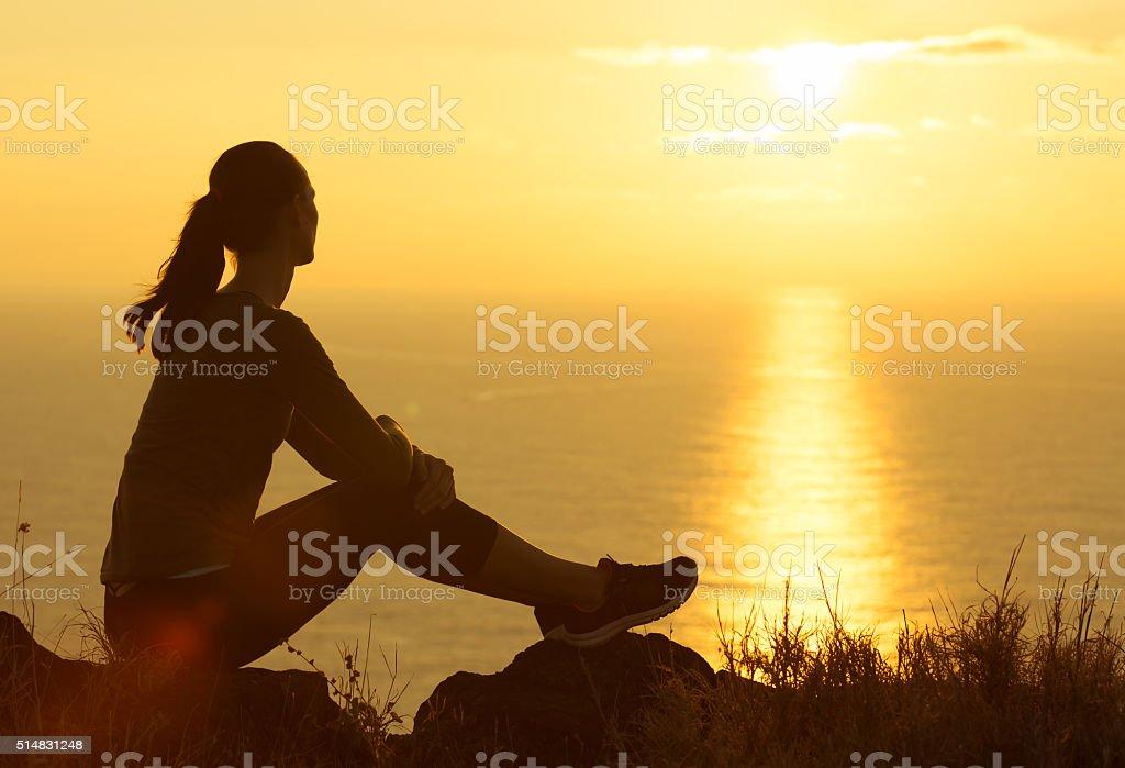 Woman watching the sunrise stock photo