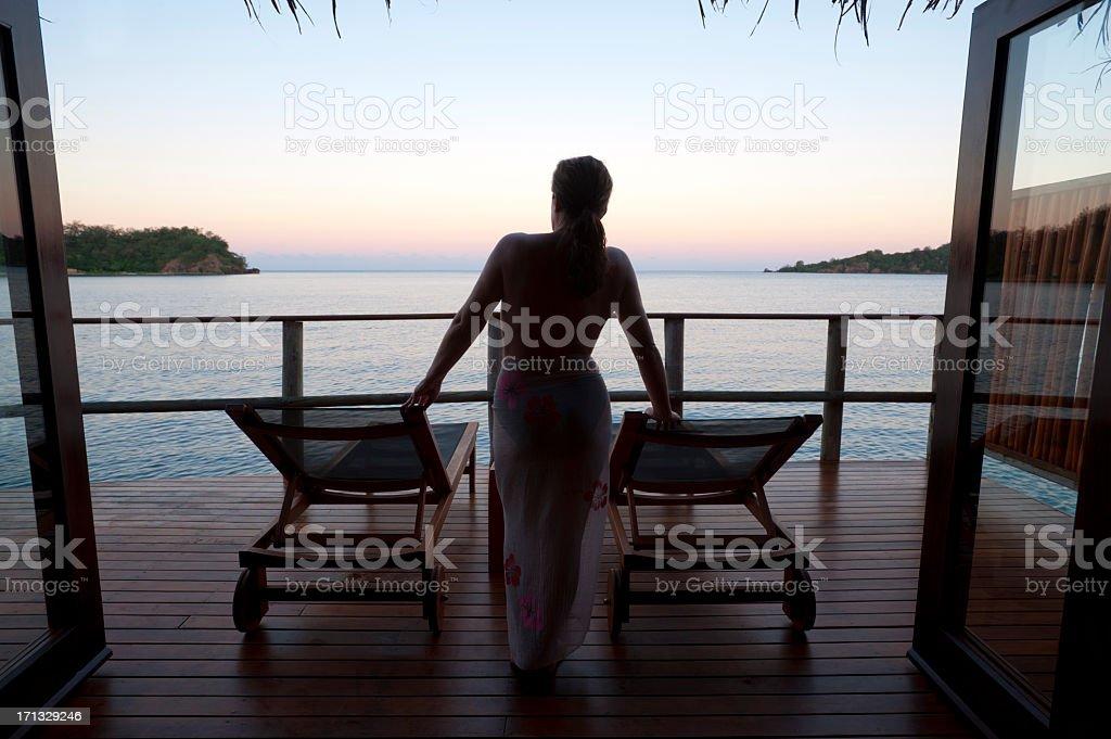 Woman watching the sunset stock photo