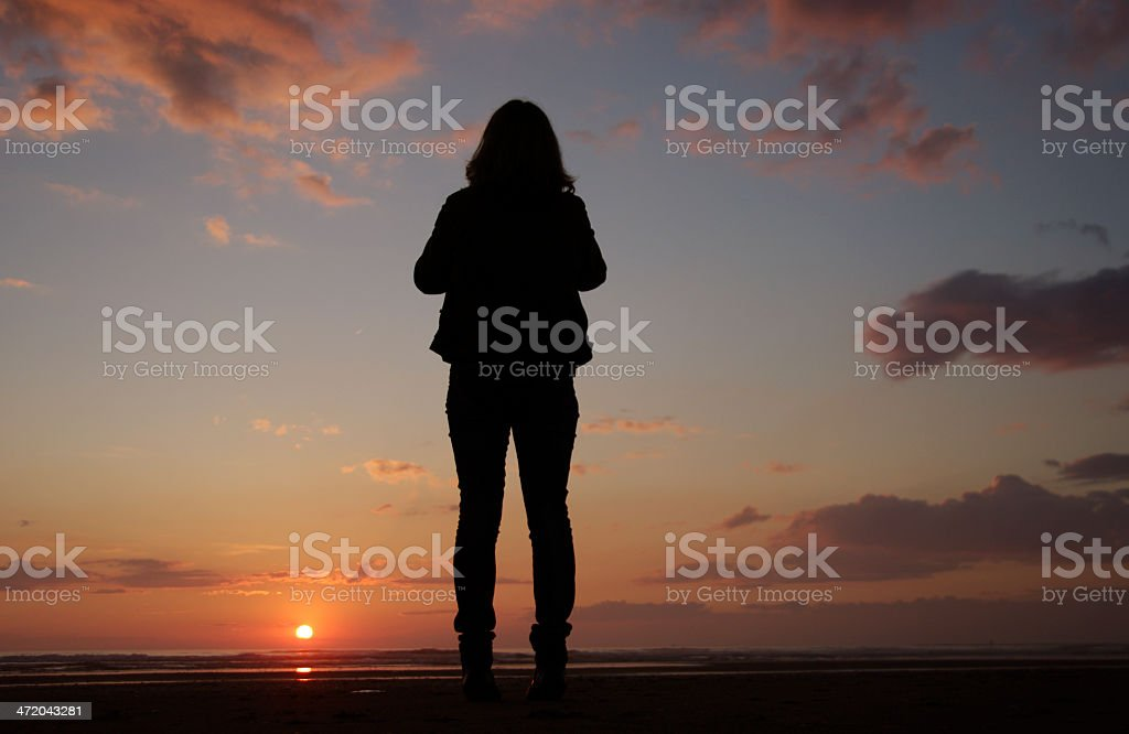 Woman watching the sunset stock photo
