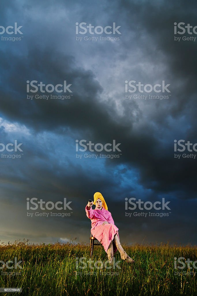 Woman watching TV in the meadow royalty-free stock photo