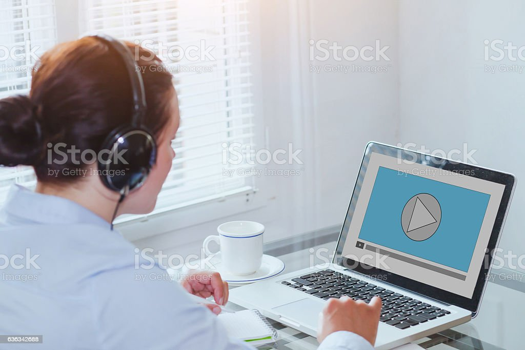 woman watching video tutorial on computer stock photo