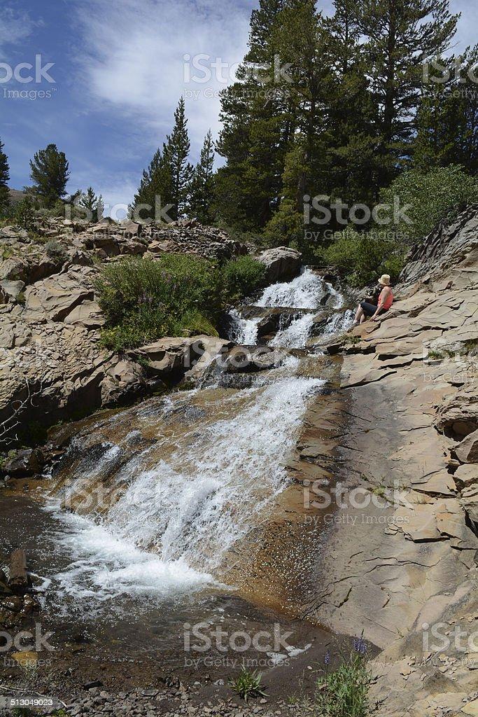 Woman Watching Waterfall royalty-free stock photo