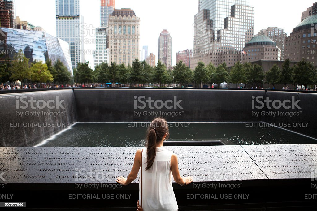 Woman watching World Trade Center memorial in New York stock photo