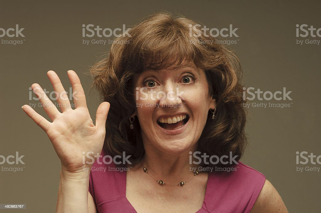 Woman Waves Welcome stock photo