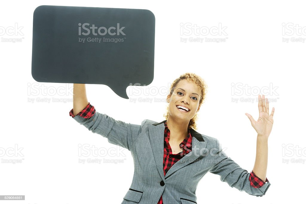 Woman waving hand & holding speech bubble stock photo