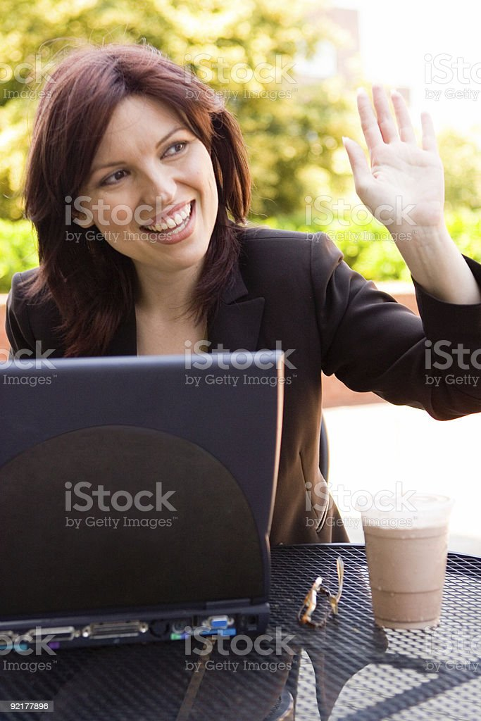 Woman waving Hello royalty-free stock photo