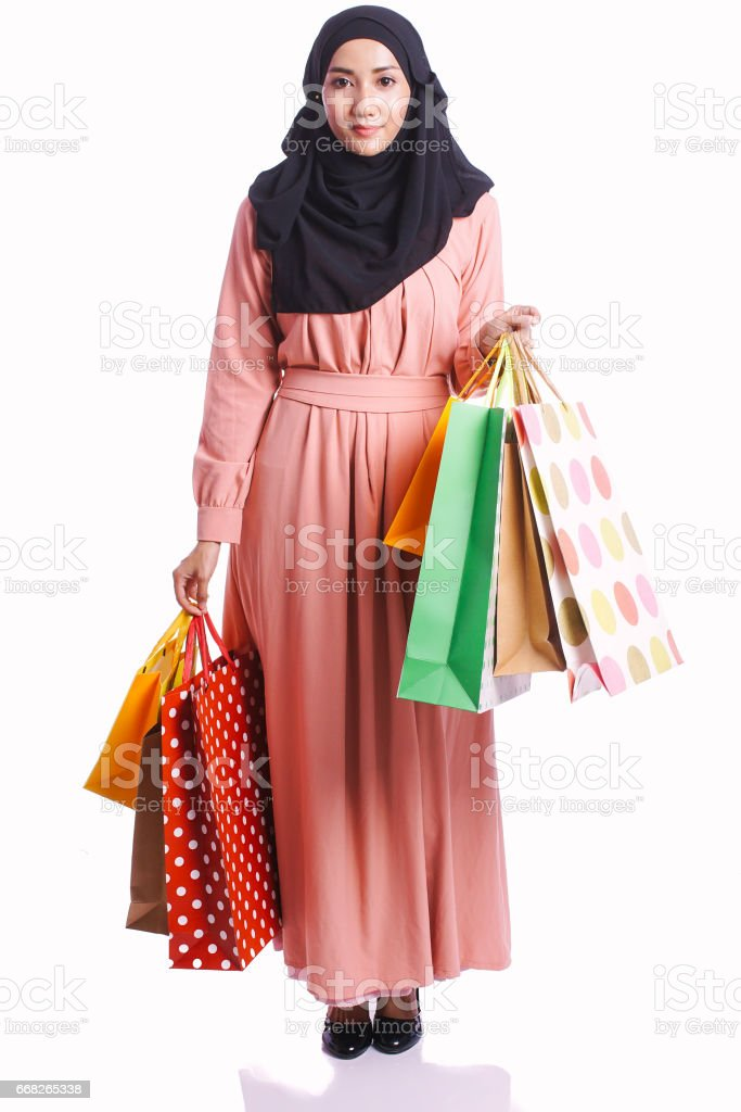 Woman wear a dress hold shopping bag enjoy buying items isolated on white background - shopping, consumer and lifestyle concept stock photo