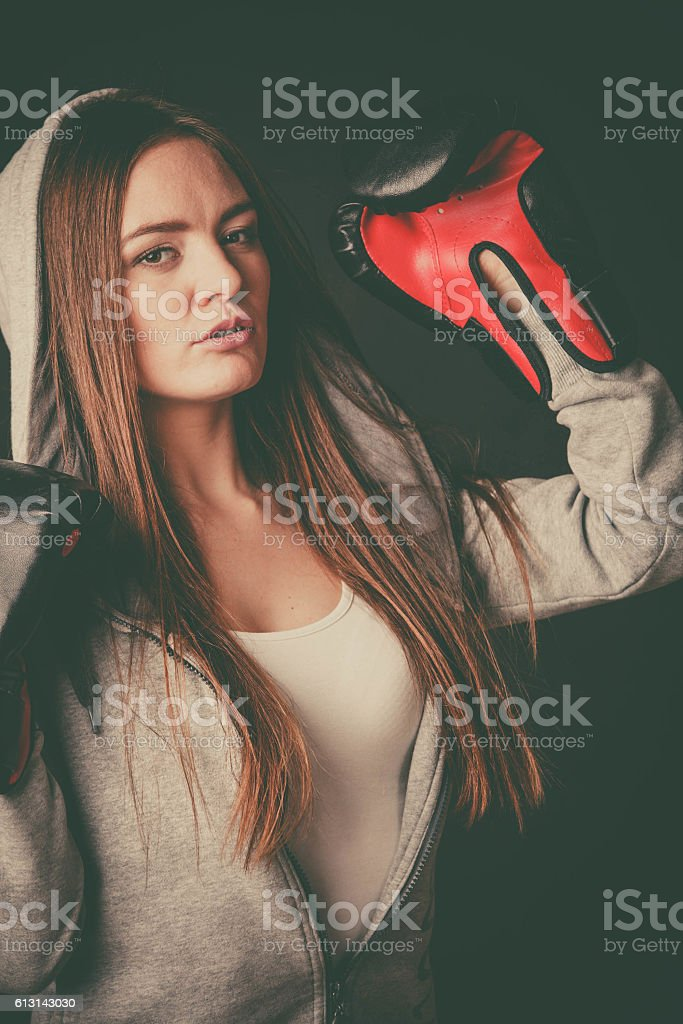 Woman wear boxer gloves with arms in air. stock photo