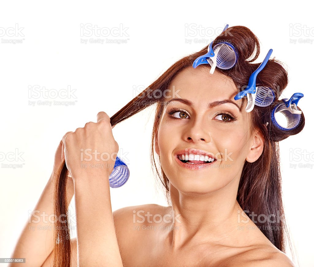 Woman wear hair curlers on head stock photo