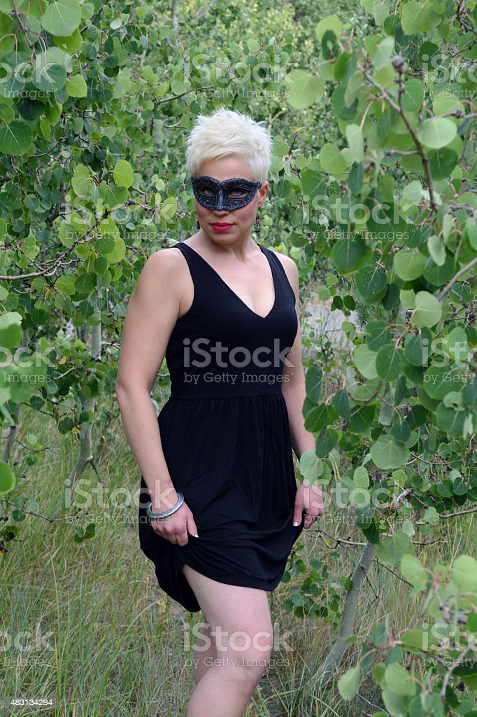 Woman Wearing a Black Mask and Black Dress royalty-free stock photo