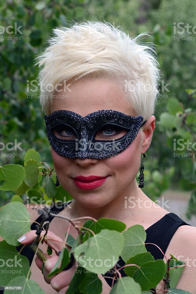 Woman Wearing a Black Mask Looking at the Camera royalty-free stock photo