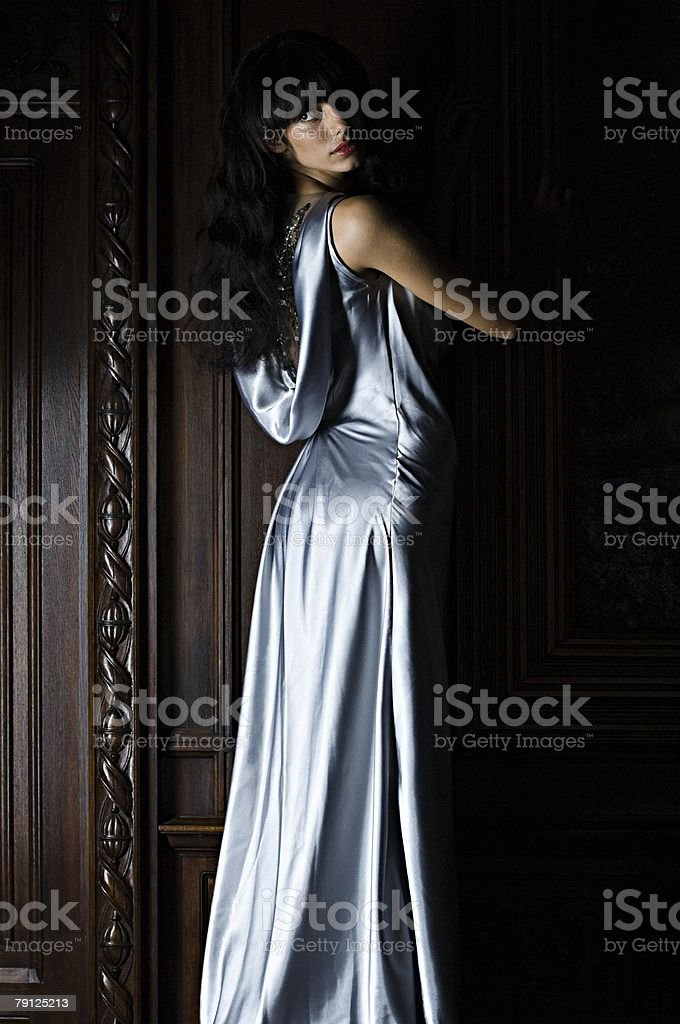 Woman wearing a blue silk dress stock photo